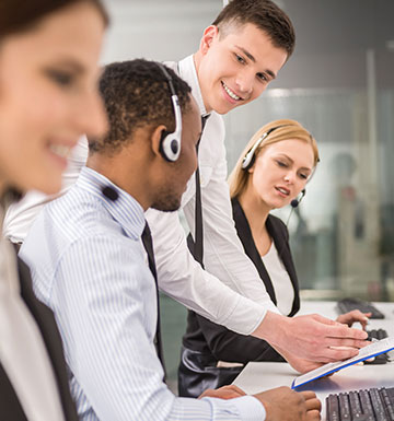 customer service scene with man wearing headset.