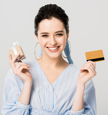 Woman holding a gift and a credit card. Gift Card.