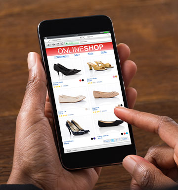 eCommerce example with someone shopping for shoes on their phone.